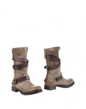 Полусапоги и высокие ботинки AMUST. Цвет: хаки