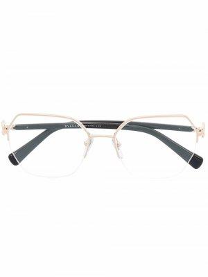 Декорированные очки в шестиугольной оправе Bvlgari. Цвет: золотистый