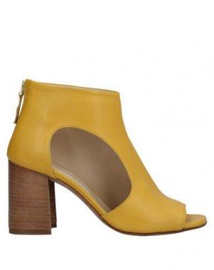 Полусапоги и высокие ботинки ANGELO BERVICATO. Цвет: желтый
