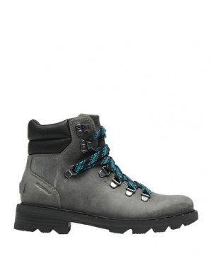 Полусапоги и высокие ботинки SOREL. Цвет: серый