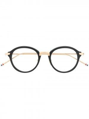 Очки TB011 в круглой оправе Thom Browne Eyewear. Цвет: золотистый