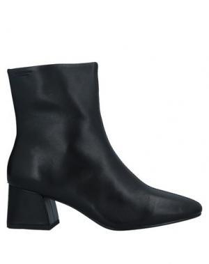 Полусапоги и высокие ботинки VAGABOND SHOEMAKERS. Цвет: черный