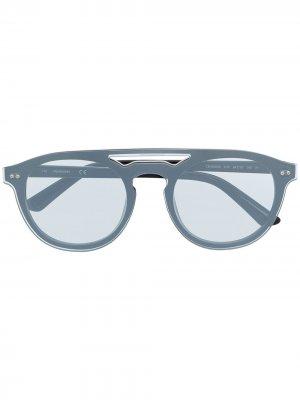 Солнцезащитные очки в круглой оправе Calvin Klein. Цвет: серебристый