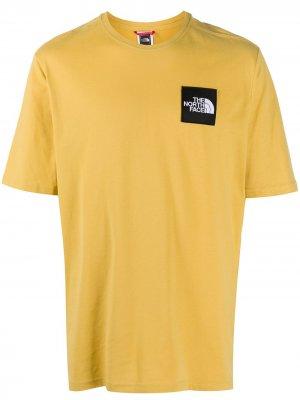 Толстовка оверсайз с нашивкой-логотипом The North Face. Цвет: желтый
