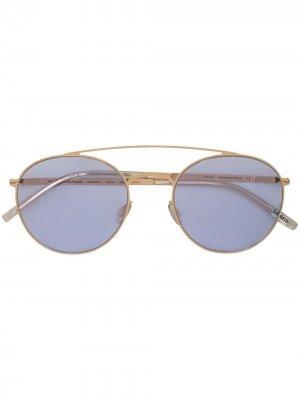 Солнцезащитные очки в круглой оправе Mykita. Цвет: золотистый