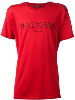 Футболки и жилеты Balmain. Цвет: красный