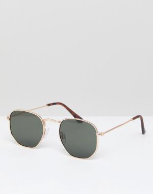 Солнцезащитные очки в золотистой оправе River Island. Цвет: золотой