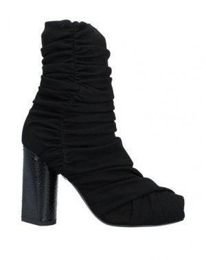 Полусапоги и высокие ботинки ROBERTO CAVALLI. Цвет: черный
