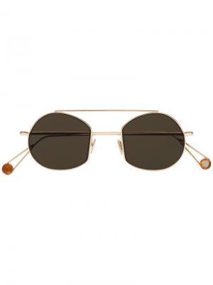 Солнцезащитные очки Ahlem. Цвет: золотистый