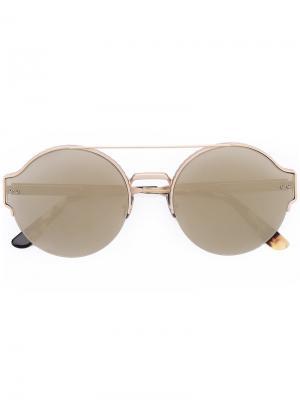 Солнцезащитные очки в круглой оправе Bottega Veneta Eyewear. Цвет: металлический