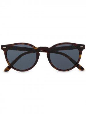 Солнцезащитные очки в круглой оправе черепаховой расцветки Polo Ralph Lauren. Цвет: коричневый