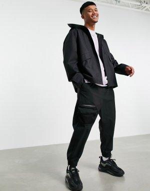 Черная водонепроницаемая куртка-дождевик с капюшоном -Черный цвет ASOS DESIGN