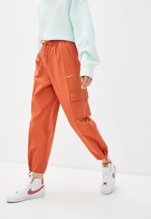 Брюки Nike W NSW ICN CLASH PANT CANVAS HR. Цвет: оранжевый