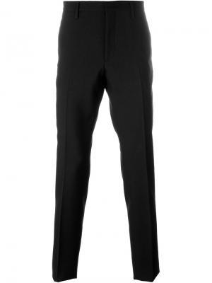 Классические брюки строгого кроя Saint Laurent. Цвет: чёрный