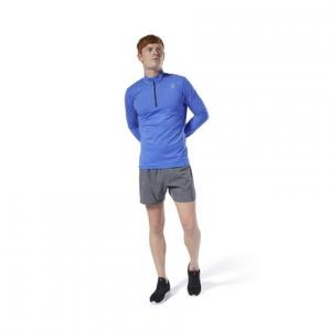 Пуловер Run Essentials Quarter Zip Reebok. Цвет: crushed cobalt
