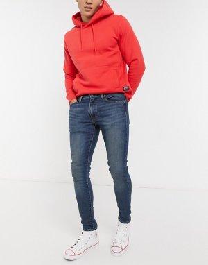 Умеренно-выбеленные джинсы зауженного кроя Levis-Голубой Levi's