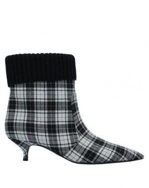 Полусапоги и высокие ботинки DIOR. Цвет: черный