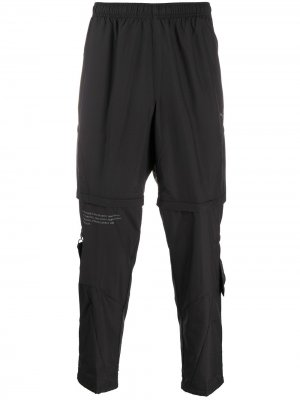 Зауженные брюки Puma. Цвет: черный