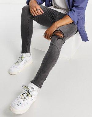 Эластичные джинсы выбеленного черного цвета с напылением, рваными коленями и потертостями -Черный цвет ASOS DESIGN