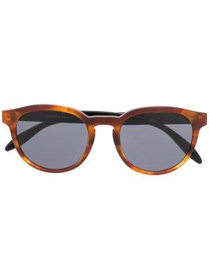 Солнцезащитные очки в овальной оправе Giorgio Armani. Цвет: коричневый