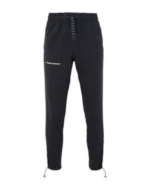 Повседневные брюки UNDER ARMOUR. Цвет: черный