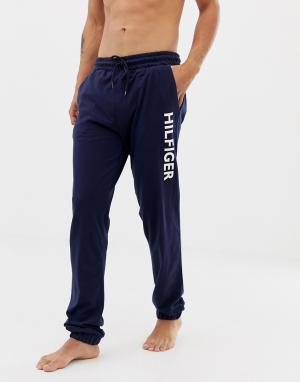 Темно-синие брюки классического кроя с манжетами и логотипом Tommy Hilfiger. Цвет: темно-синий