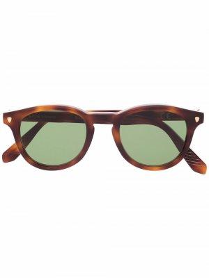 Солнцезащитные очки в круглой оправе черепаховой расцветки Epos. Цвет: коричневый