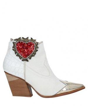 Полусапоги и высокие ботинки GIANCARLO PAOLI. Цвет: белый